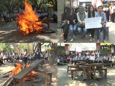 Irate students of DM College of Arts set ablaze desks and benches of the college
