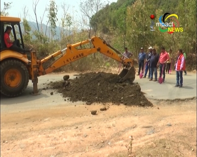 Owners and Drivers of Tata D-I repair pot holes on National highway 102, Indo-Myanmar road